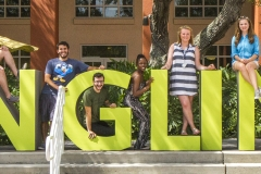 Admissions Student Tour Guides Atop Ringling Letters