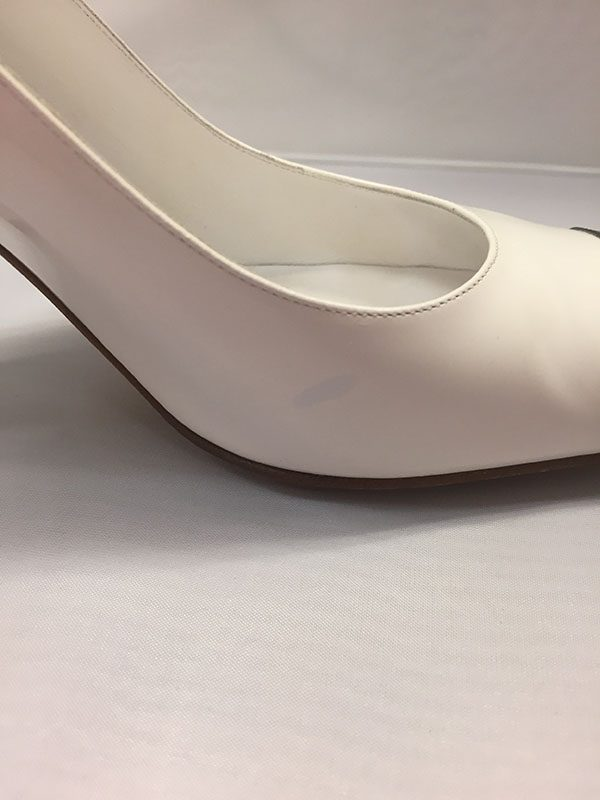 Chanel White Patent Leather Pumps with Black Patent Toe Blue Mark on Shoe