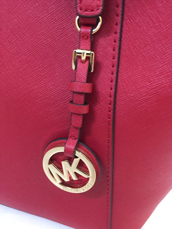 Michael Kors Jet Set Tote Logo Tag Close Up View