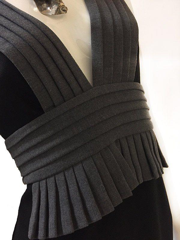 Black Halo Sleeveless Dress Pleat Close Up View